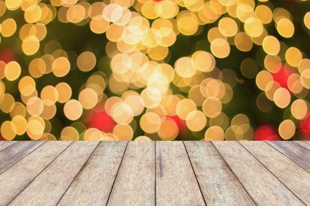 holiday lights display: Christmas Light Bokeh background with wood floor