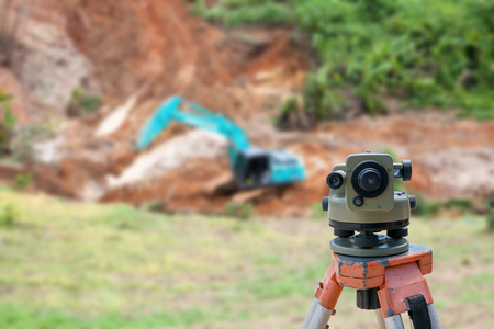 surveyor: Surveyor equipment tacheometer or theodolite at construction site