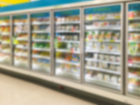 Commercial refrigerators in a large supermarket blurred background