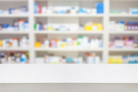 pharmacy counter with blur shelves of drug in the pharmacy drugstore background