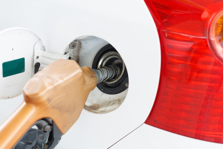 fill up: To fill the machine with fuel. Car fill with gasoline at a gas station. Gas station pump.Car gas fill up. Stock Photo