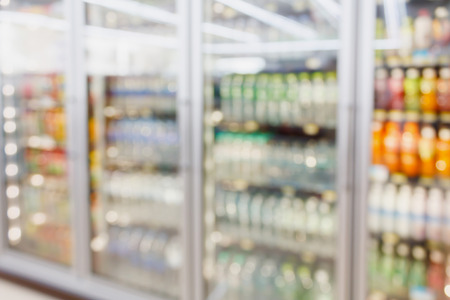 convenience store refrigerator shelves blurred background Banco de Imagens