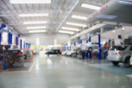 car repair maintenance service center blurred background