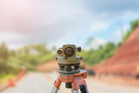theodolite: theodolite instrument for road construction surveyor equipment with road construction site works blur background Stock Photo
