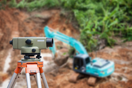 tacheometer: Surveyor equipment tacheometer or theodolite at construction site