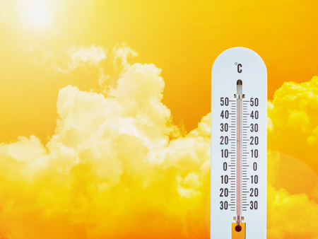 thermometer in the sky, hot temperature Stock Photo