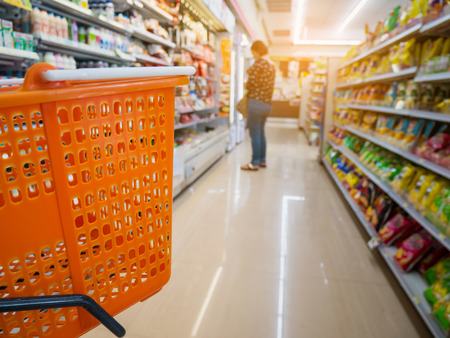 empty basket on shopping cart in supermarket or convenience store Banco de Imagens