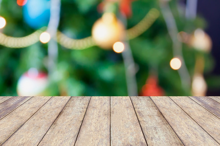 holiday lights display: Christmas holiday background with empty rustic wood table
