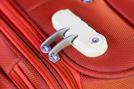 combination: combination lock on red suitcase travel bag Stock Photo