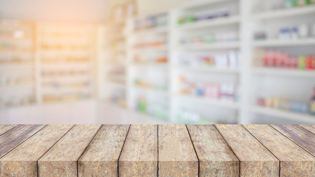wood table top over pharmacy interior with blurred background Standard-Bild