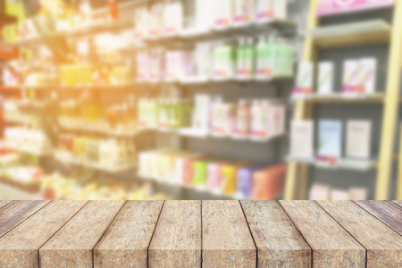 beauty store: wood table top on blur health beauty store shelves background