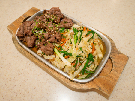 japanese cooking: Beef with vegetables on hot plate, beef teppanyaki Japanese Cooking