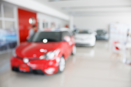new car at new car showroom dealership blurred background Stock Photo