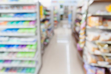 convenience: convenience store shelves blurred background