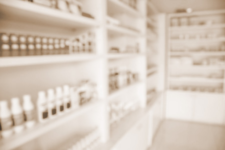 over the counter: pharmacy shelves filled with medication blur background Stock Photo