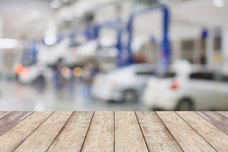 garage background: Wood table top with blur garage background, for product display or montage your products Stock Photo