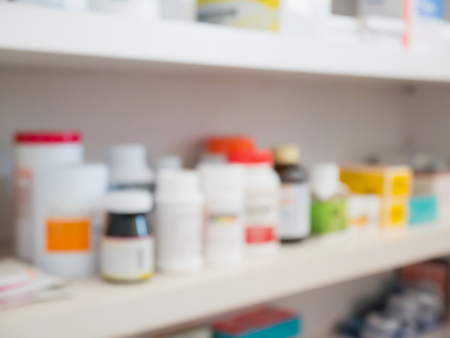 over the counter: Close up of medicine bottles on shelves of drugs in the pharmacy store blur background Stock Photo