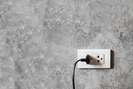 plug socket: white plug socket on the room wall