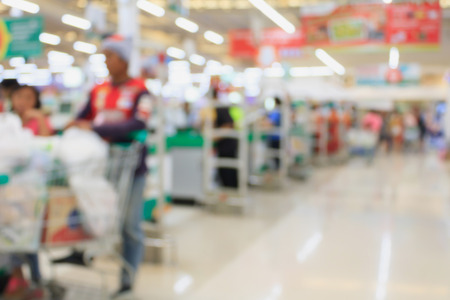 supermarket checkout: supermarket checkout payment terminal with customers blurred background