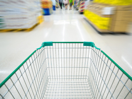 shopping cart in supermarket blur background