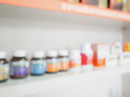 over the counter: Close up of medicine bottles on shelves of drugs in the pharmacy, Pharmacy drugstore blurred background Stock Photo