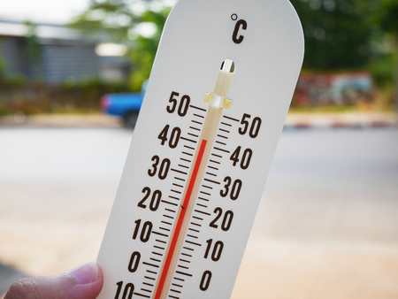 hot temperature: hand hold thermometer showing temperature in degrees Celsius, Hot temperature