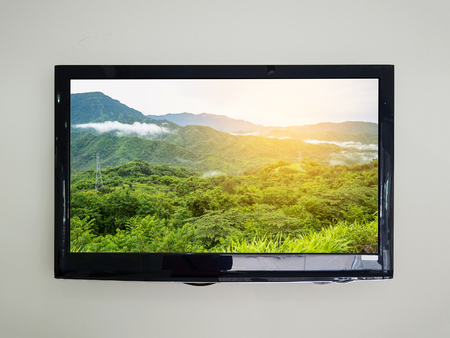 flat screen: Led tv on the wall background with nature scene on television screen