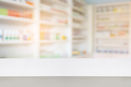 wood counter with blur shelves of drug in the pharmacy drugstore background