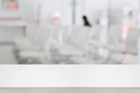 counter service: white counter with Blur abstract hospital, office, hotel or bank interior background with customer or patient at cashier counter service. For product display Stock Photo
