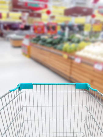 shopping for some fruits and vegetables in supermarket with shopping cart