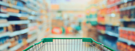 Shopping in Supermarket with shopping cart, vintage tone Stock Photo