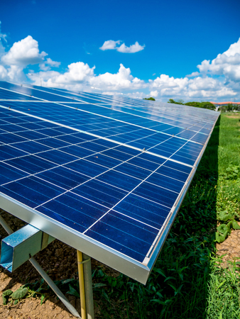 Solar panels with blue sky and clouds, solar energy environmentally friendly green energy Stock Photo