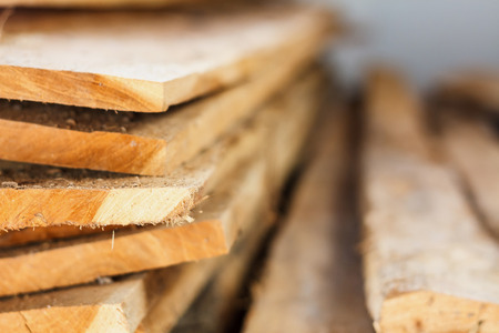 Large stack of wood planks, teak wood Stock Photo