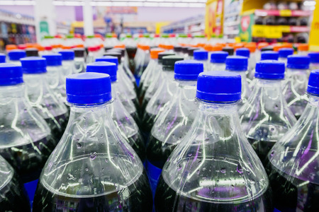 soft sell: Carbonated soft drink bottles close up