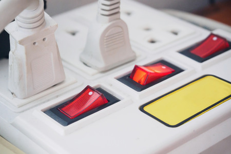 unplugging: Multiple power socket with connected plugs
