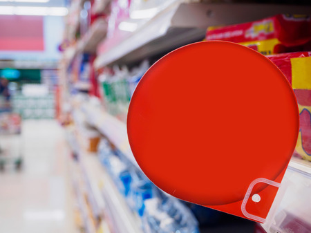 pricing: blank red discount sign display on supermarket shelves Stock Photo