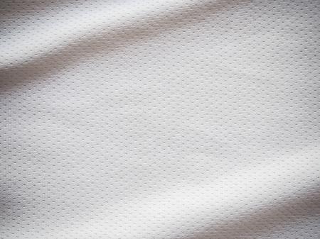Witte de textuurachtergrond van de sport Jersey stof