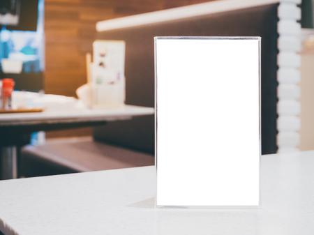 Mock up Blank Menu frame on Table in cafe restaurant