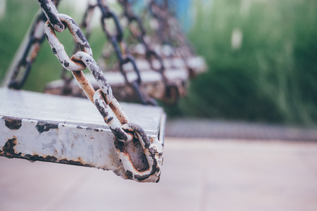 chain swing ride: old wood swing in playground park Stock Photo