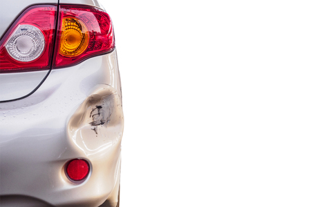 car has dented rear bumper damaged after accident isolated on white