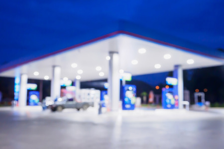 unleaded: Blur Gas station at night time for background