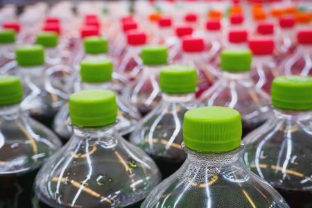 soft sell: soda soft drinks in bottles in supermarket Stock Photo