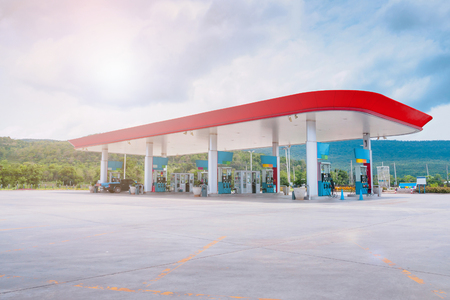 Gas fuel station with clouds in the sky and sun light