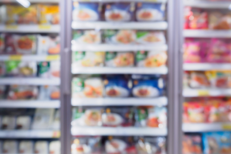 Abstract supermarket refrigerator for storage frozen food product in grocery store Foto de archivo
