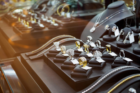 Gold jewelry diamond shop with rings and necklaces luxury retail store window display showcase Фото со стока - 85955540