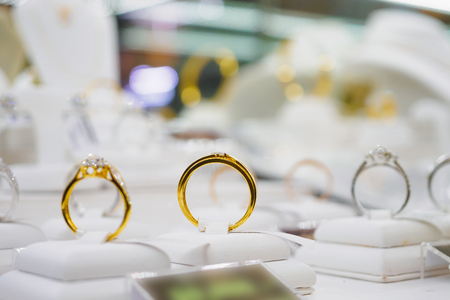 Jewelry diamond rings and necklaces show in luxury retail store window display showcase Stock Photo