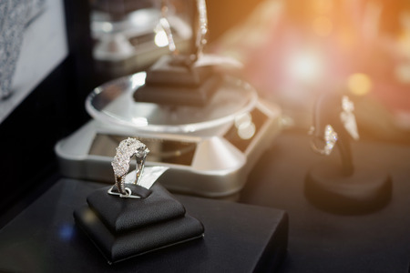 Diamond rings with blank price tag show in jewelry luxury store window display showcase