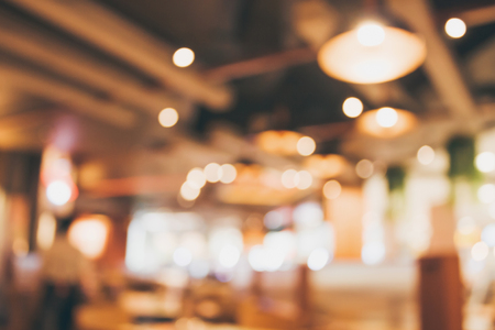 Restaurant cafe or coffee shop interior with people abstract defocused blur background Standard-Bild