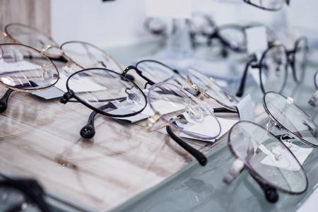 Eye glasses on window display shelves in optics store