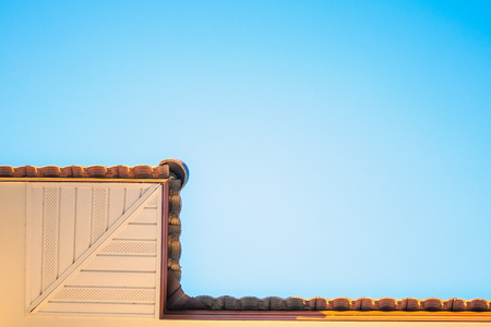 Soffit Board Installation with blue sky